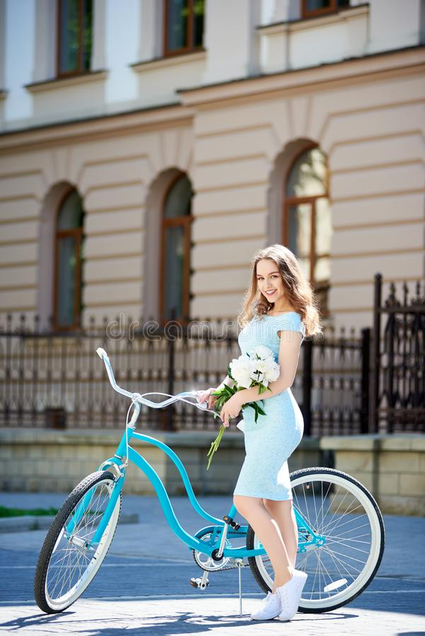 Attractive young woman enjoying riding her bicycle stock photography