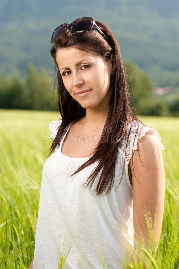 Attractive young woman on grain field stock photography