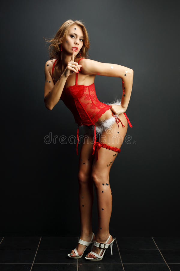 Attractive Young Woman With Her Finger Up Stock Photo