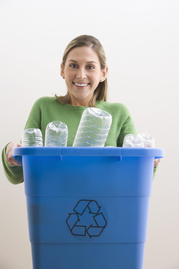 Download Attractive Young Woman Holding A Blue Recycle Bin Royalty Free Stock Photo - Image: 14648125