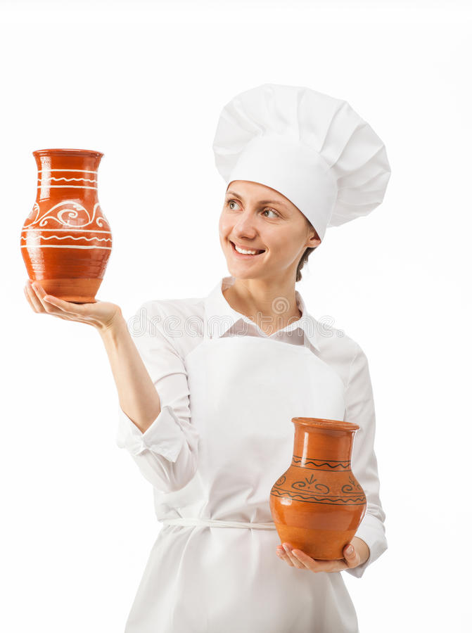 Attractive young woman holding clay jugs. On white background stock image