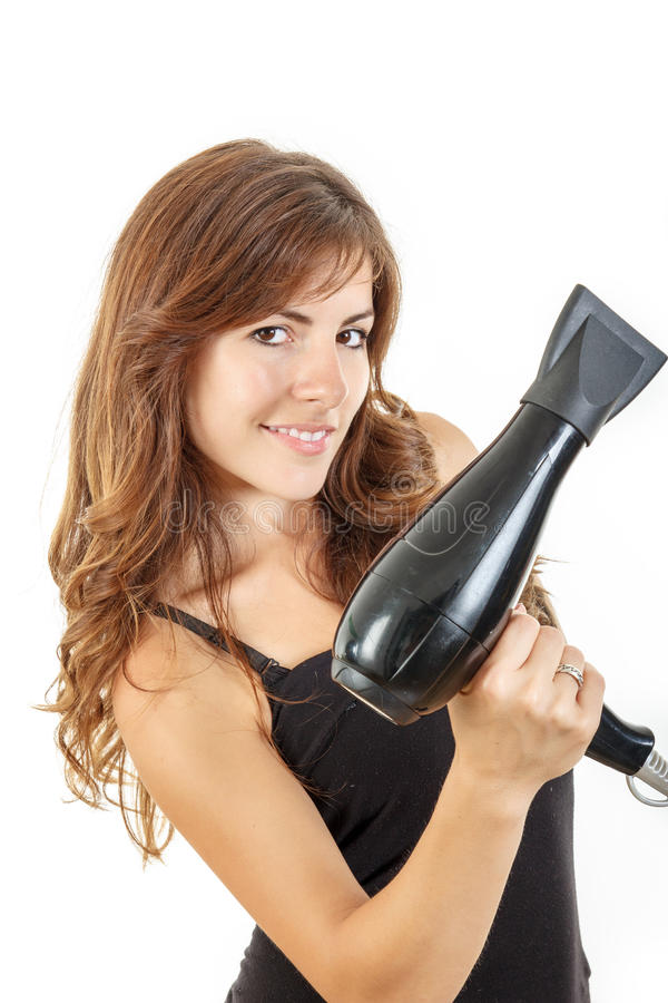 Attractive young woman holding hairdryer stock photo