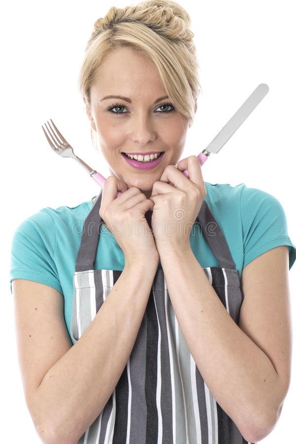 Attractive Young Woman Holding Knife and Fork. Happy Attractive Young Woman Holding Knife and Fork stock photography