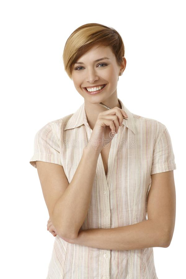 Attractive young woman holding pen stock photo