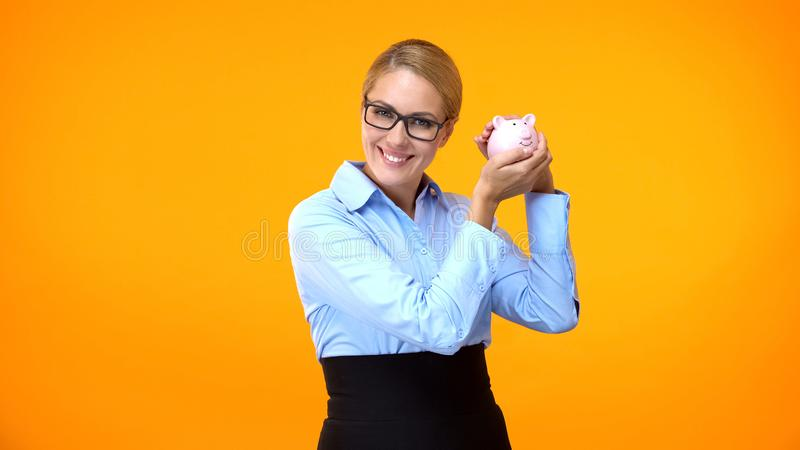 Attractive young woman holding piggybank, bank account, financial fund, savings stock images
