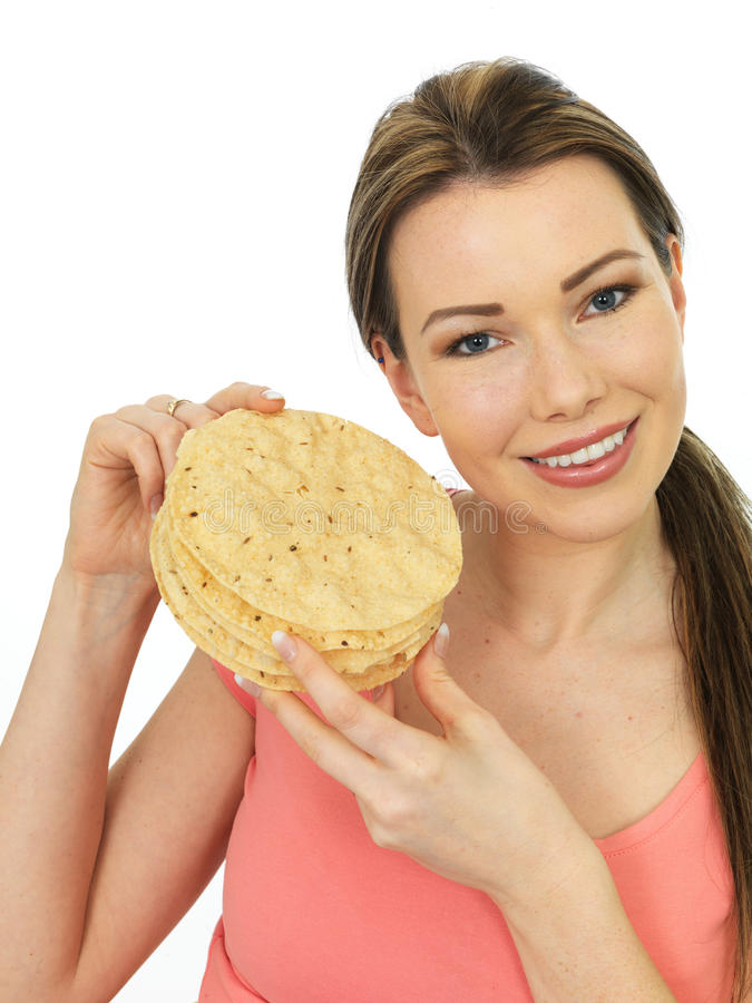 Attractive Young Woman Holding A Pile Of Indian Style Poppadoms royalty free stock photography