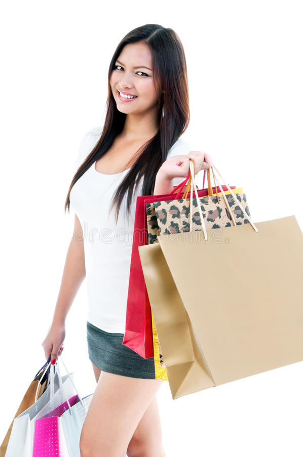 Attractive Young Woman Holding Shopping Bags