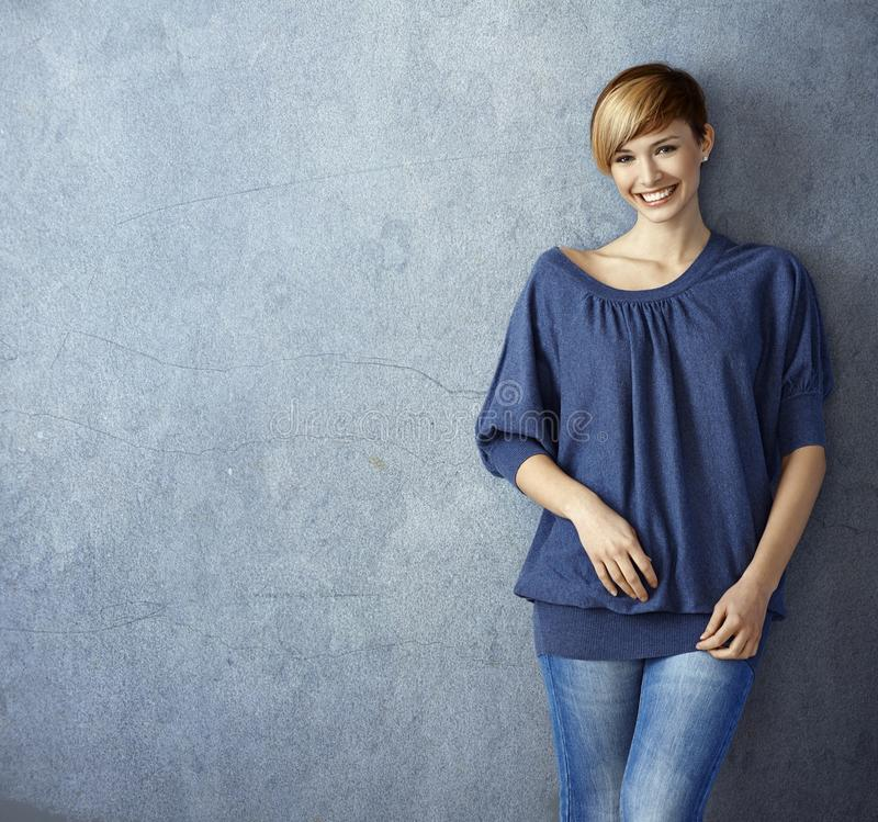 Attractive young woman in jeans stock image