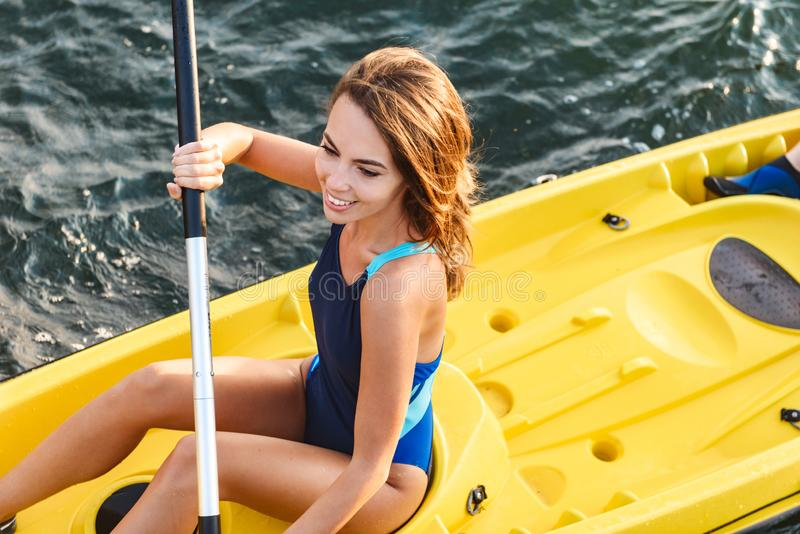 Attractive young woman kayaking stock photos