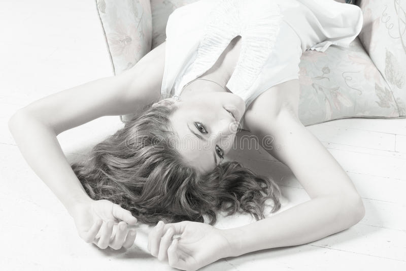 Download Attractive Young Woman Laying On The Floor Stock Image - Image: 26759437