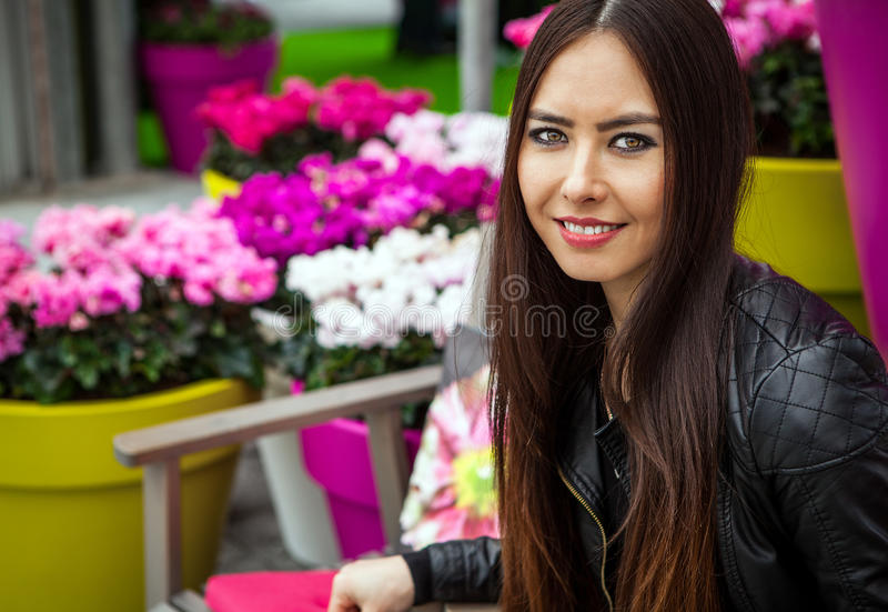 Attractive young woman with long beautiful hairs posing in flower greenhouse of Keukenhof park.  royalty free stock photo
