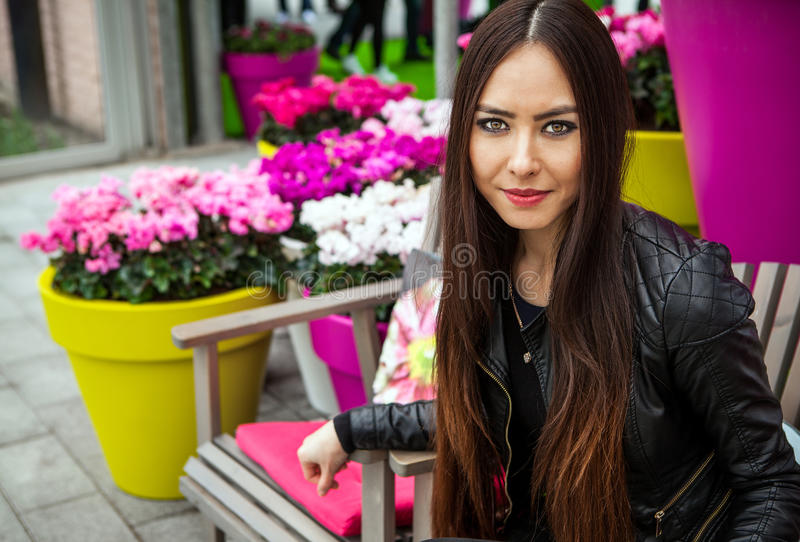Attractive young woman with long beautiful hairs posing in flower greenhouse of Keukenhof park.  stock images