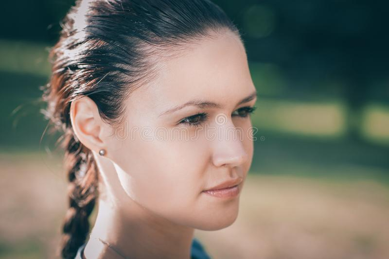 Attractive young woman looking off into the distance. Close up. attractive young woman looking off into the distance royalty free stock photography