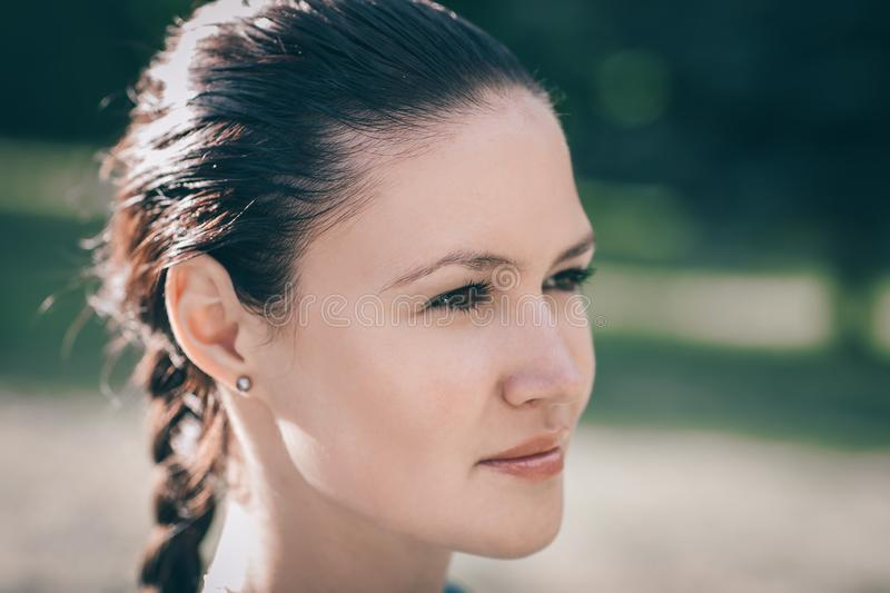 Attractive young woman looking off into the distance. Close up. attractive young woman looking off into the distance royalty free stock photos