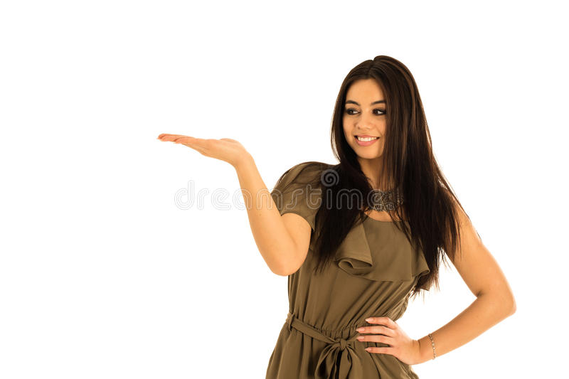 Attractive young woman looking at your product royalty free stock photo