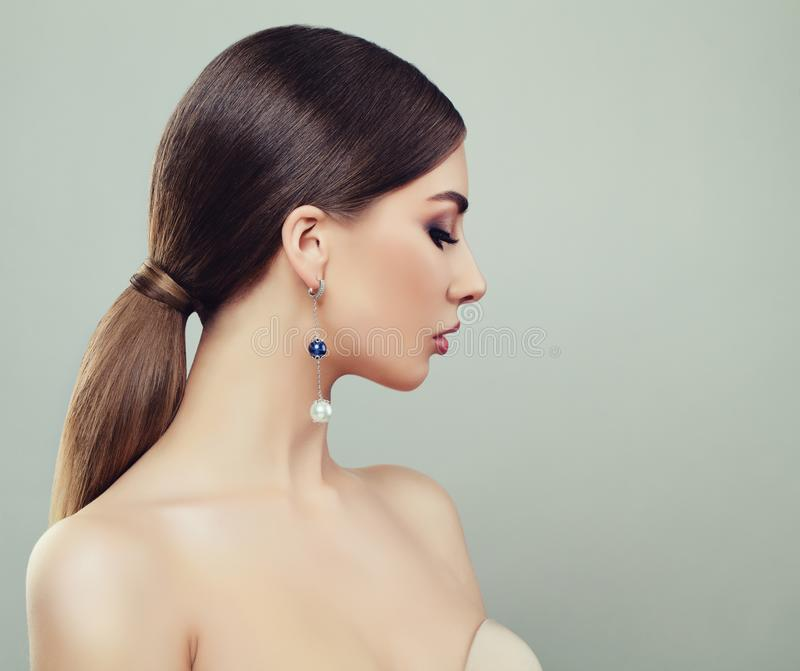 Attractive Young Woman with Makeup, Healthy Ponytail Hairstyle royalty free stock photo