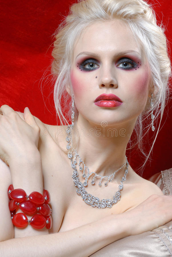 Attractive young woman in Moulin Rouge style royalty free stock image