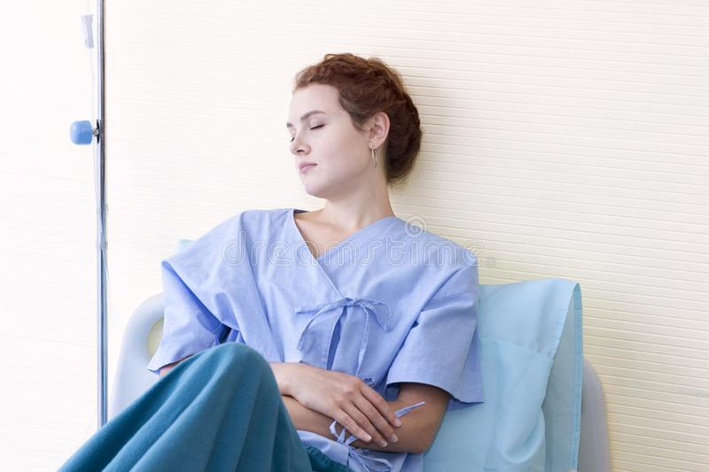 Attractive young woman patient thinking and dream about life stock image