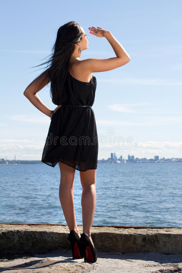 Attractive young woman on the pier royalty free stock photography
