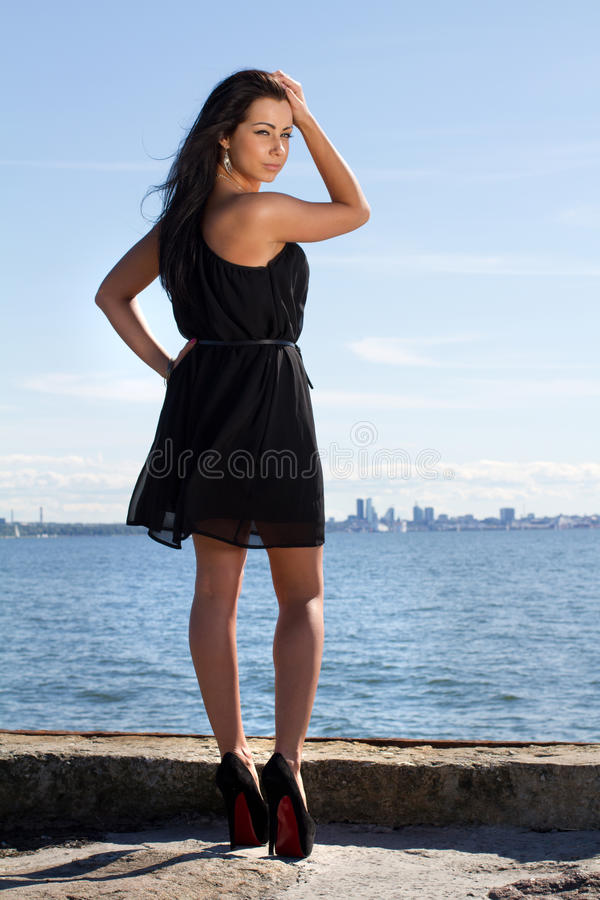 Attractive young woman on the pier stock photos