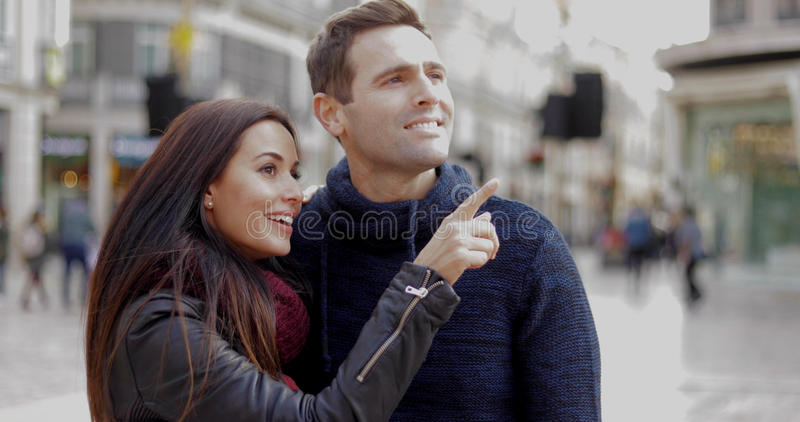 Attractive young woman pointing out something stock images