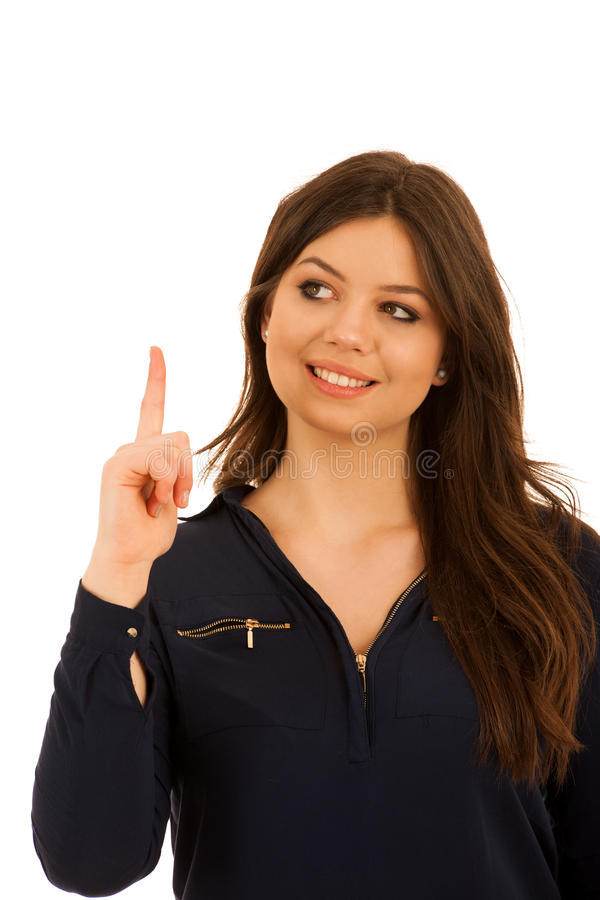 Attractive young woman pointing to copy space isolated over whit royalty free stock photography