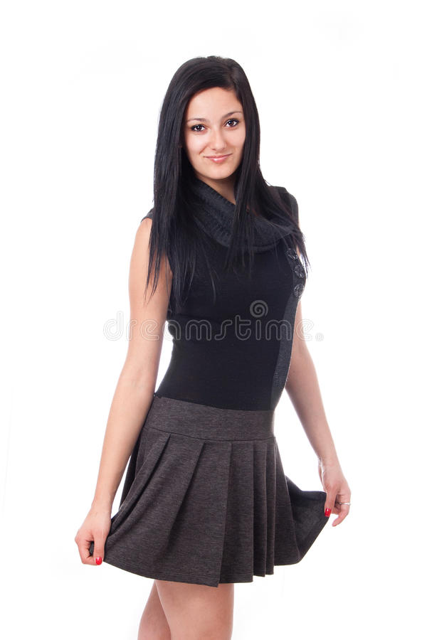 Attractive young woman posing in black dress royalty free stock photography