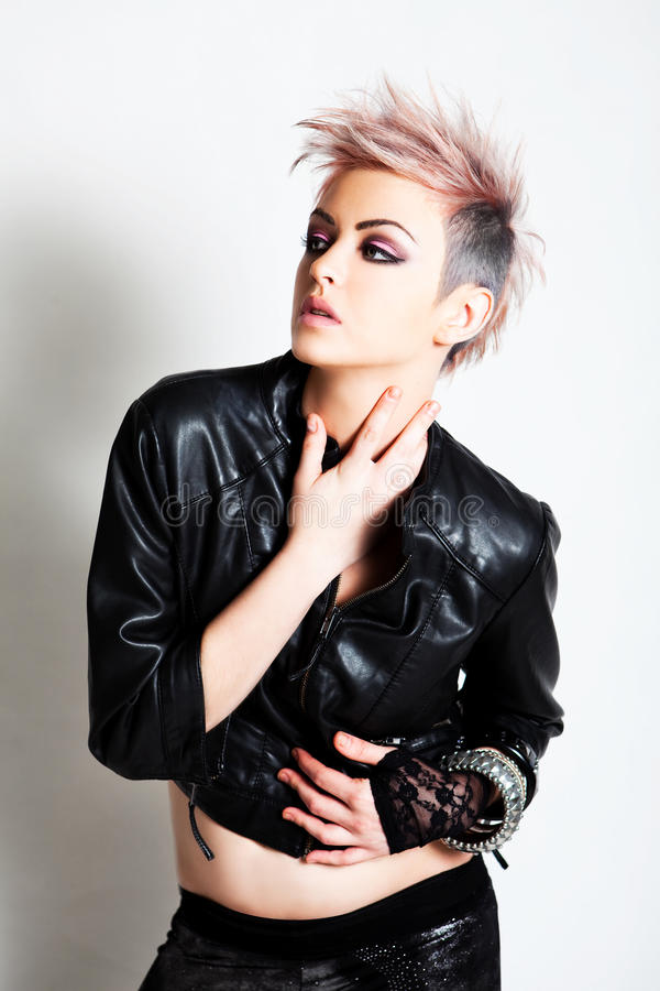 Attractive Young Woman in Punk Attire royalty free stock photo
