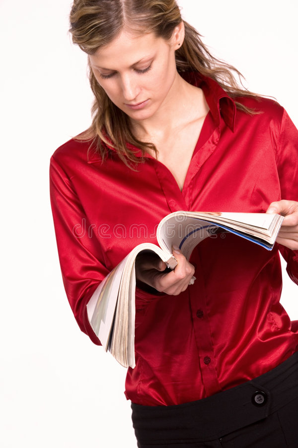 Attractive Young Woman Reading Magazine Stock Photos