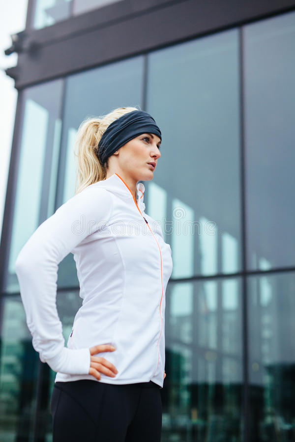 Attractive young woman ready for her running session. Shot of an attractive young woman ready for her running session. Fitness female athlete standing outdoors stock images