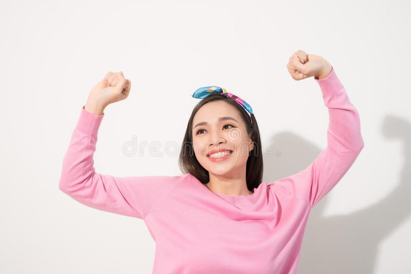 Attractive young woman relax and dance on copy space. Portrait of happy girl dancing your hands up on white background stock photos