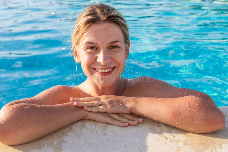 Woman relaxing at pool royalty free stock photos