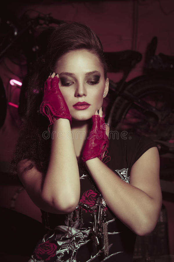 Attractive young woman in rock style clothing royalty free stock photography