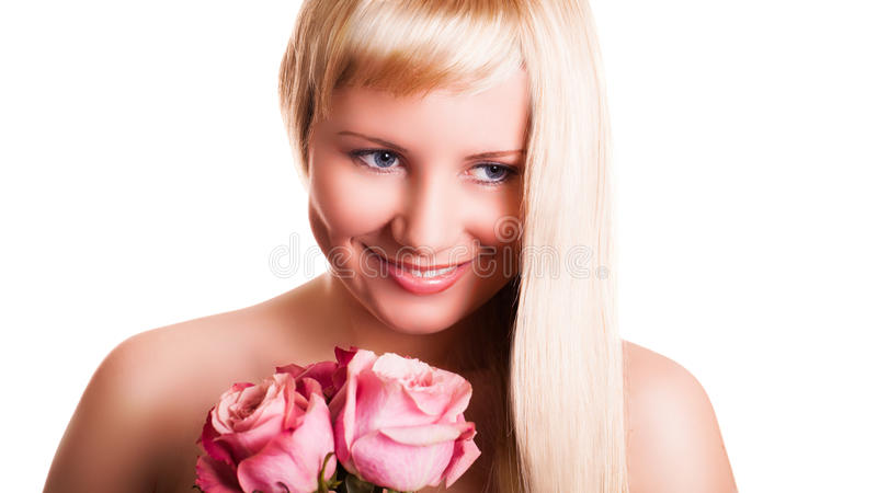 Attractive young woman with roses stock photo