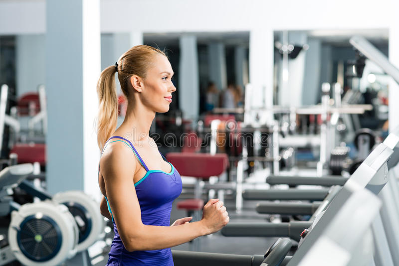 Download Attractive Young Woman Runs On A Treadmill Stock Image - Image: 28265323