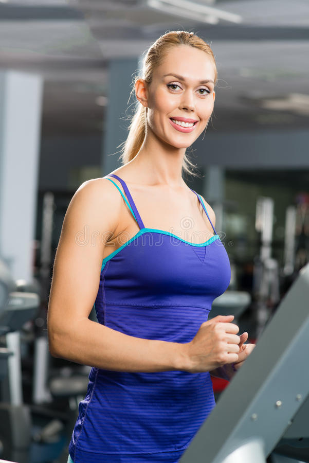 Download Attractive Young Woman Runs On A Treadmill Stock Image - Image: 28339937
