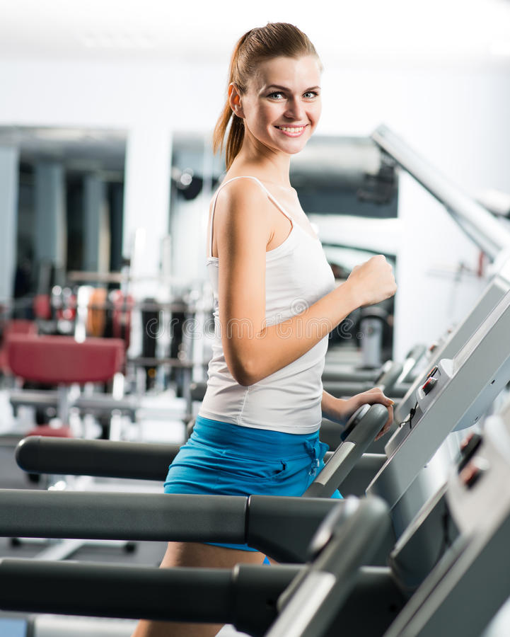 Download Attractive Young Woman Runs On A Treadmill Stock Photo - Image of fitness, enjoy: 28639902