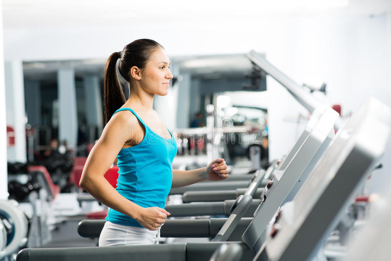 Download Attractive Young Woman Runs On A Treadmill Royalty Free Stock Photo - Image: 29394645