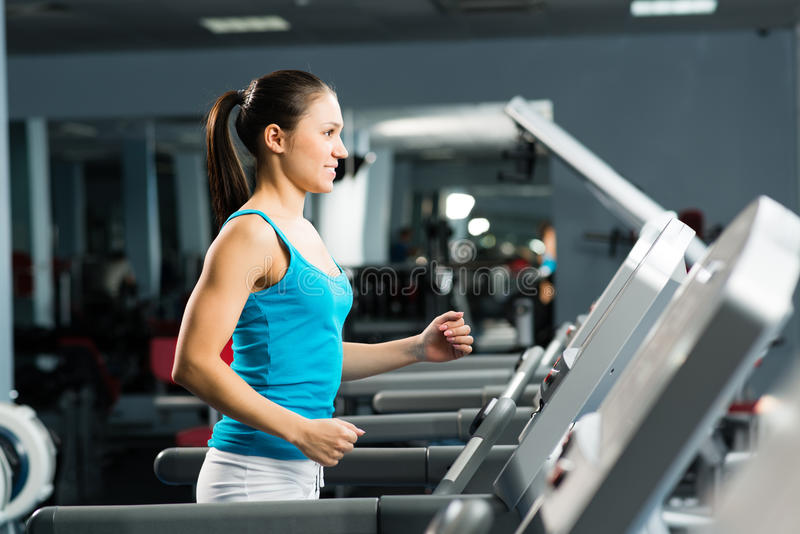 Download Attractive Young Woman Runs On A Treadmill Stock Image - Image: 29505167