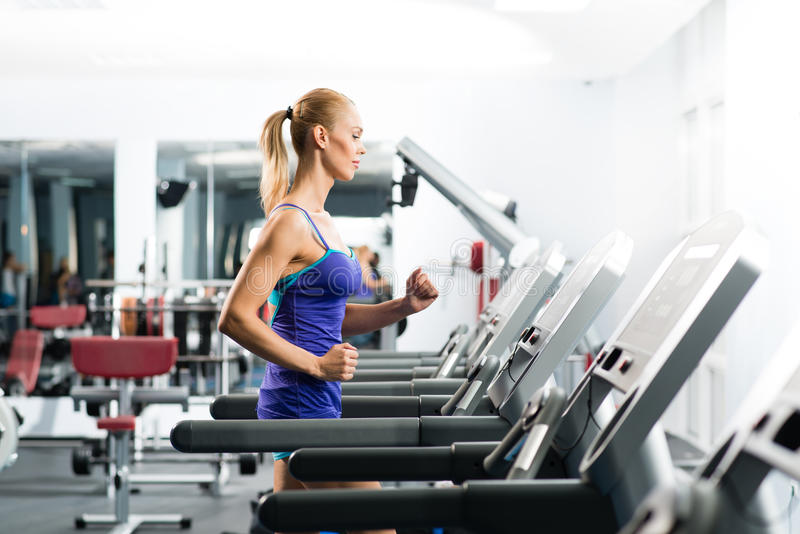 Download Attractive Young Woman Runs On A Treadmill Royalty Free Stock Photos - Image: 31762698