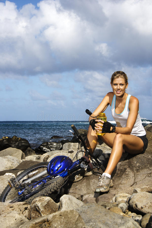 Attractive Young Woman Sitting With Bicycle Royalty Free Stock Images