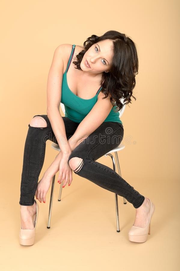 Free Attractive Young Woman Sitting On A Chair In High Heel Shoes Stock Images - 52732984