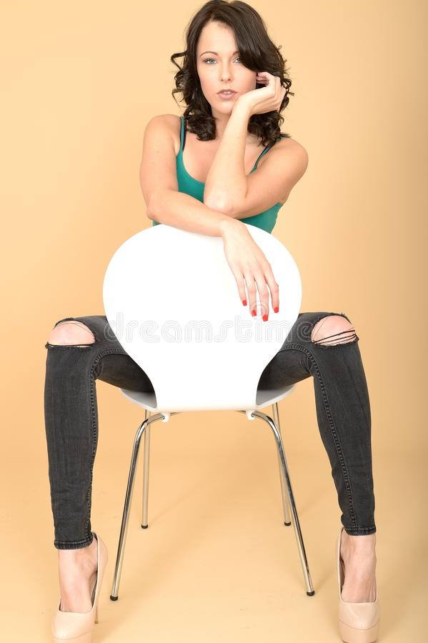 Free Attractive Young Woman Sitting On A Chair In High Heel Shoes And Royalty Free Stock Photography - 52994957
