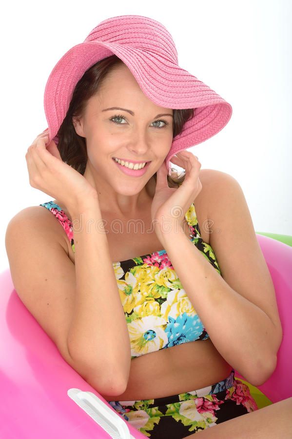 Attractive Young Woman Sitting in Rubber Rings Wearing a Swimsuit royalty free stock image