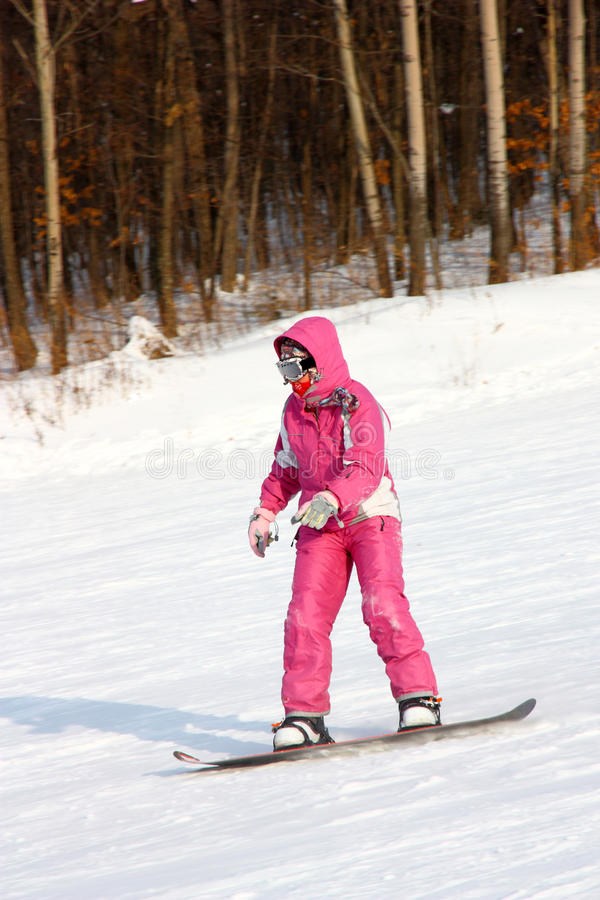 Attractive young woman skiing stock photography