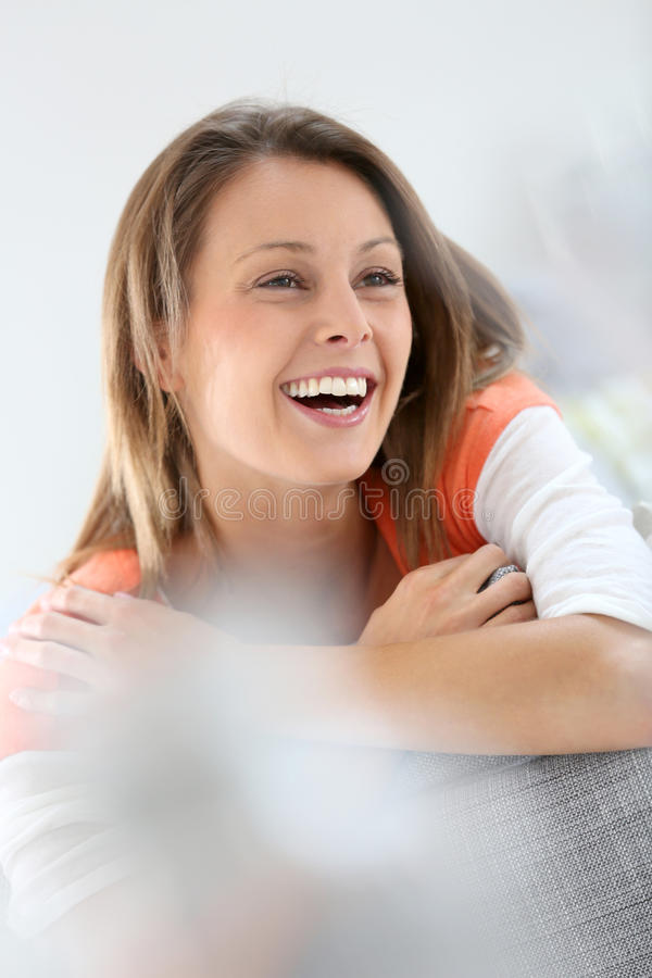 Attractive young woman smiling. Portrait of attractive young woman stock photo