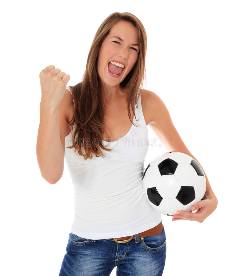 Attractive young woman with soccer ball royalty free stock photography