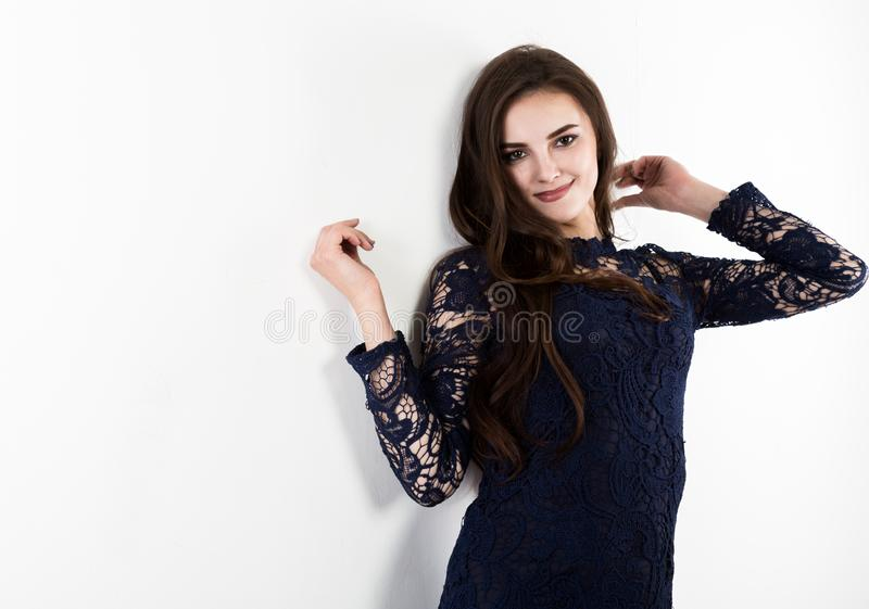 Attractive young woman standing near white wall. free space for text royalty free stock photos