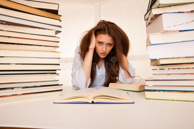 Attractive young woman student undre stress while studiing for e stock photos