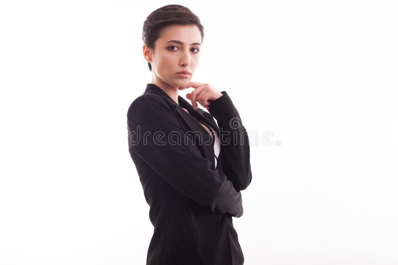 Attractive young woman in stylish black jacket posing over white background looking at the camera stock photo